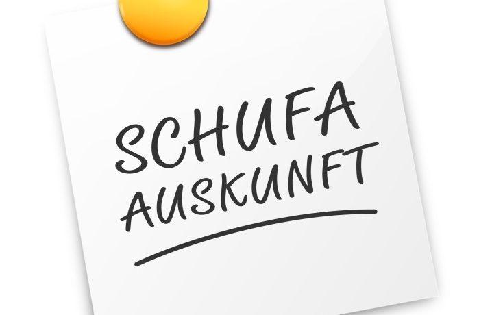 Pin mit der Aufschrift Schufa Auskunft